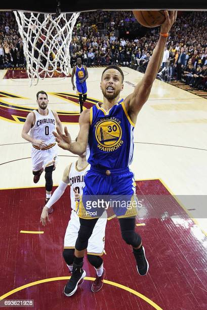 Stephen Curry of the Golden State Warriors shoots in the second half against Kyle Korver of the Cleveland Cavaliers in Game 3 of the 2017 NBA Finals...