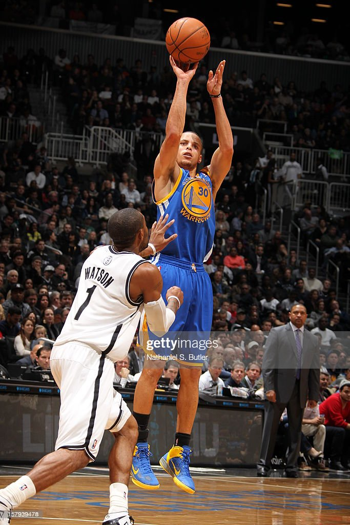 Stephen Curry #30 of the Golden State Warriors shoots over <a gi-track='captionPersonalityLinkClicked' href=/galleries/search?phrase=C.J.+Watson&family=editorial&specificpeople=740190 ng-click='$event.stopPropagation()'>C.J. Watson</a> #1 of the Brooklyn Nets on December 7, 2012 at the Barclays Center in the Brooklyn Borough of New York City.