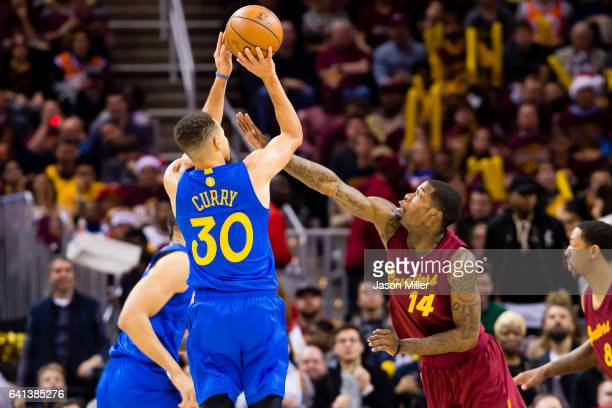 Stephen Curry of the Golden State Warriors shoots over DeAndre Liggins of the Cleveland Cavaliers during the second half at Quicken Loans Arena on...
