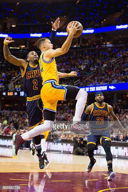 Stephen Curry of the Golden State Warriors shoots over Kyrie Irving and LeBron James of the Cleveland Cavaliers during the first half at Quicken...