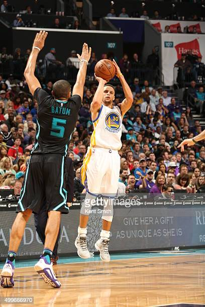 Stephen Curry of the Golden State Warriors shoots the ball against the Charlotte Hornets on December 2 2015 at Time Warner Cable Arena in Charlotte...