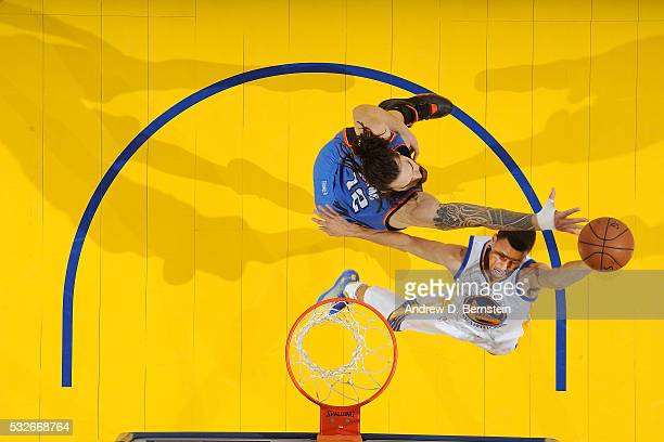 Stephen Curry of the Golden State Warriors shoots the ball against Steven Adams of the Oklahoma City Thunder in Game Two of the Western Conference...