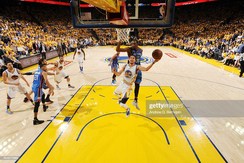 <a gi-track='captionPersonalityLinkClicked' href=/galleries/search?phrase=Stephen+Curry+-+Basketballer&family=editorial&specificpeople=5040623 ng-click='$event.stopPropagation()'>Stephen Curry</a> #30 of the Golden State Warriors shoots the ball against <a gi-track='captionPersonalityLinkClicked' href=/galleries/search?phrase=Kevin+Durant&family=editorial&specificpeople=3847329 ng-click='$event.stopPropagation()'>Kevin Durant</a> #35 of the Oklahoma City Thunder in Game Five of the Western Conference Finals during the 2016 NBA Playoffs on May 26, 2016 at ORACLE Arena in Oakland, California.