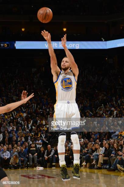Stephen Curry of the Golden State Warriors shoots the ball against the Utah Jazz on April 10 2017 at ORACLE Arena in Oakland California NOTE TO USER...