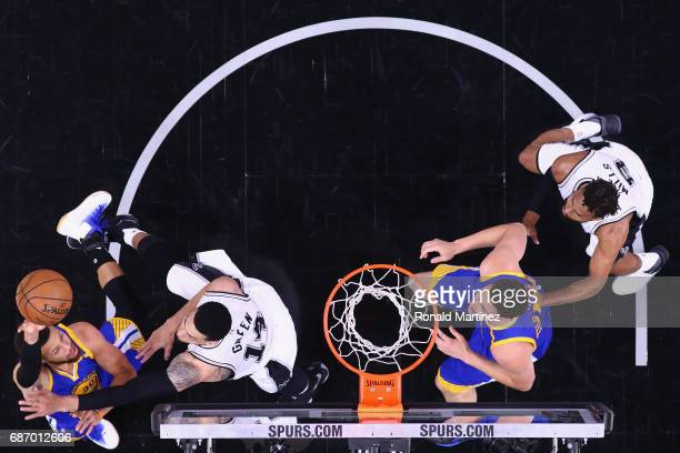 Stephen Curry of the Golden State Warriors shoots the ball against Danny Green of the San Antonio Spurs in the first half during Game Four of the...
