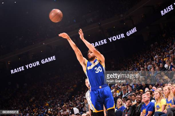 Stephen Curry of the Golden State Warriors shoots the ball during the game against the Washington Wizards on April 2 2017 at ORACLE Arena in Oakland...