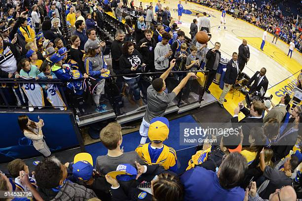 Stephen Curry of the Golden State Warriors shoots the ball from the tunnel before the game against the Orlando Magic on March 7 2016 at ORACLE Arena...