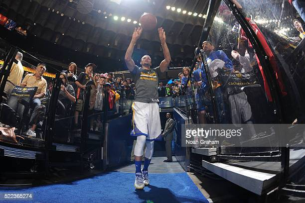 Stephen Curry of the Golden State Warriors shoots the ball from the tunnel before the game against the Philadelphia 76ers on March 27 2016 at Oracle...