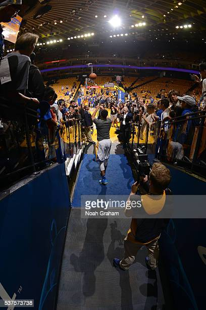 Stephen Curry of the Golden State Warriors shoots the ball from the tunnel before Game Five of the Western Conference Finals against the Oklahoma...