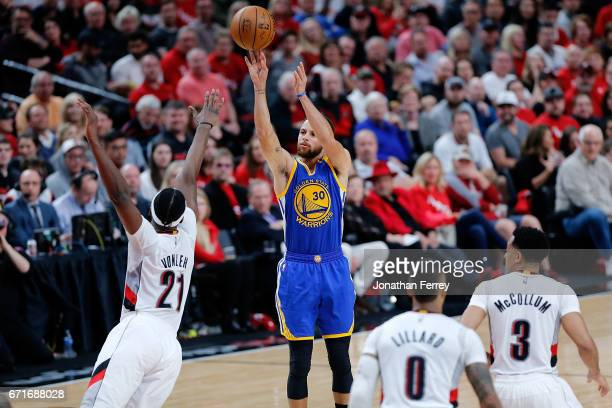 Stephen Curry of the Golden State Warriors shoots the ball over Noah Vonleh of the Portland Trail Blazers during Game Three of the Western Conference...