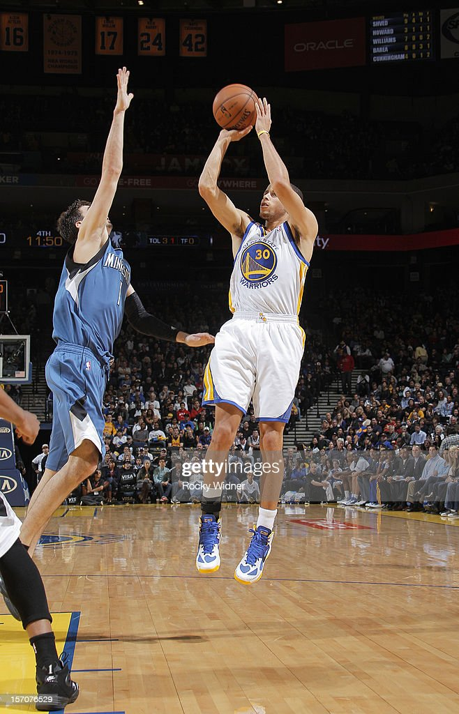 Stephen Curry #30 of the Golden State Warriors shoots the ball over <a gi-track='captionPersonalityLinkClicked' href=/galleries/search?phrase=Alexey+Shved&family=editorial&specificpeople=5557761 ng-click='$event.stopPropagation()'>Alexey Shved</a> #1 of the Minnesota Timberwolves on November 24, 2012 at Oracle Arena in Oakland, California.