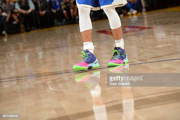 Stephen Curry of the Golden State Warriors showcases his sneakers against the Cleveland Cavaliers on December 25 2015 at ORACLE Arena in...
