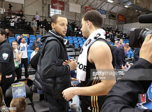 Stephen Curry of the Golden State Warriors shows his support of Seth Curry of the Erie Bayhawks while playing against the Iowa Energy of the during...