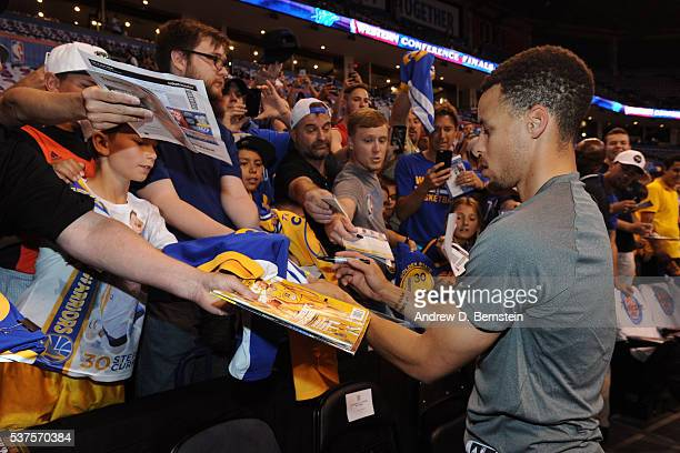 Stephen Curry of the Golden State Warriors signs autographs before Game Four of the Western Conference Finals against the Oklahoma City Thunder...