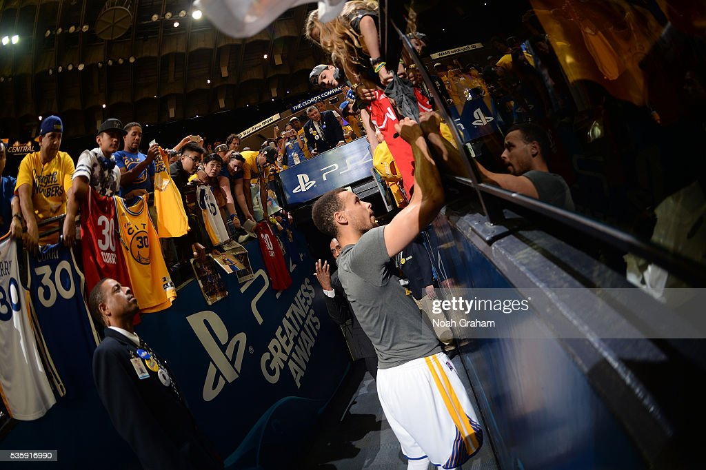 <a gi-track='captionPersonalityLinkClicked' href=/galleries/search?phrase=Stephen+Curry+-+Basketball+Player&family=editorial&specificpeople=5040623 ng-click='$event.stopPropagation()'>Stephen Curry</a> #30 of the Golden State Warriors signs autographs for fans before the game against the Oklahoma City Thunder in Game Seven of the Western Conference Finals during the 2016 NBA Playoffs on May 30, 2016 at ORACLE Arena in Oakland, California.