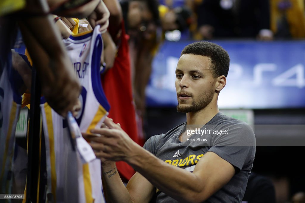 <a gi-track='captionPersonalityLinkClicked' href=/galleries/search?phrase=Stephen+Curry+-+Basketball+Player&family=editorial&specificpeople=5040623 ng-click='$event.stopPropagation()'>Stephen Curry</a> #30 of the Golden State Warriors signs autographs for fans prior to Game Seven of the Western Conference Finals against the Oklahoma City Thunder during the 2016 NBA Playoffs at ORACLE Arena on May 30, 2016 in Oakland, California.