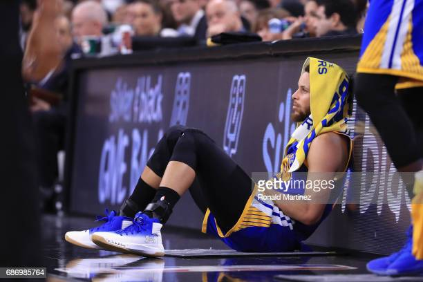 Stephen Curry of the Golden State Warriors sits on the court in the first half against the San Antonio Spurs during Game Four of the 2017 NBA Western...