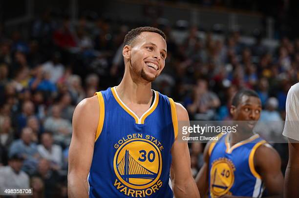 Stephen Curry of the Golden State Warriors smiles during the game against the Denver Nuggets on November 22 2015 at the Pepsi Center in Denver...