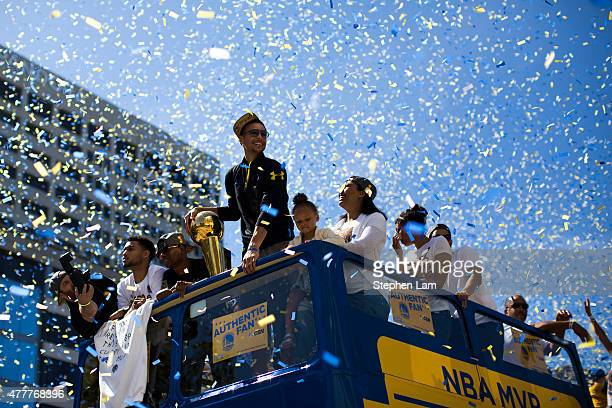 Stephen Curry of the Golden State Warriors smiles toward the crowd during the Golden State Warriors Victory Parade in Oakland California Thousands...