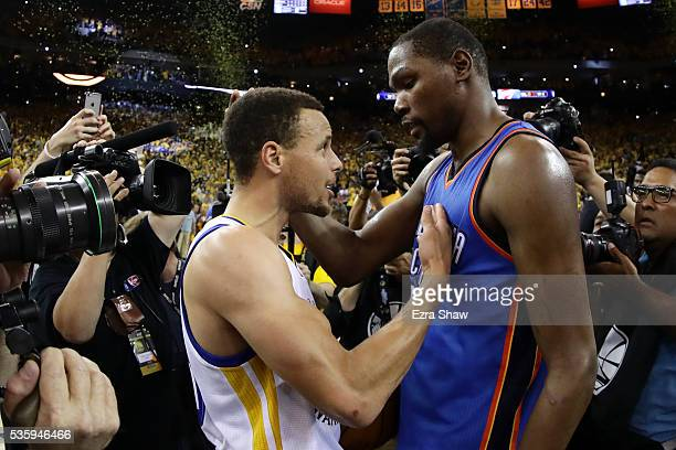 Stephen Curry of the Golden State Warriors speaks with Kevin Durant of the Oklahoma City Thunder after their 9688 win in Game Seven of the Western...