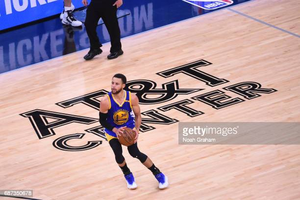 Stephen Curry of the Golden State Warriors spots up for a three point basket in Game Four of the Western Conference Finals against the San Antonio...