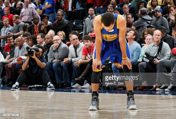Stephen Curry of the Golden State Warriors stands during free throws in the final seconds of their 124116 loss to the Atlanta Hawks at Philips Arena...