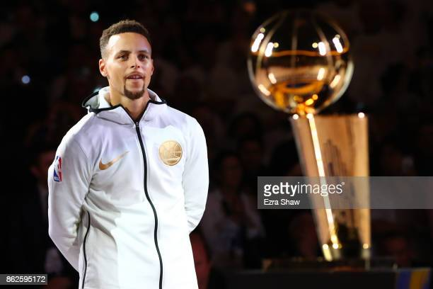 Stephen Curry of the Golden State Warriors stands during their 2017 NBA Championship ring ceremony prior to their NBA game against the Houston...