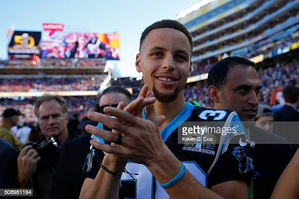 Stephen Curry of the Golden State Warriors stands on the field prior to Super Bowl 50 between the Denver Broncos and the Carolina Panthers at Levi's...