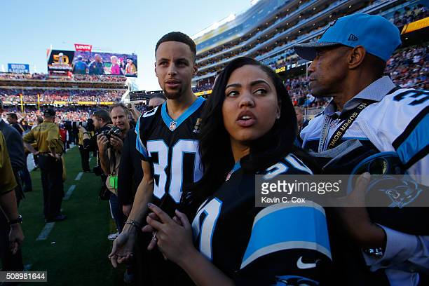 Stephen Curry of the Golden State Warriors stands on the field with his wife Ayesha prior to Super Bowl 50 between the Denver Broncos and the...