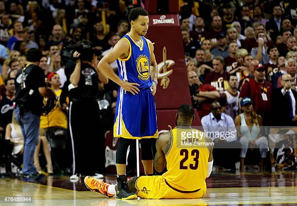 Stephen Curry of the Golden State Warriors stands over LeBron James of the Cleveland Cavaliers in the fourth quarter during Game Three of the 2015...