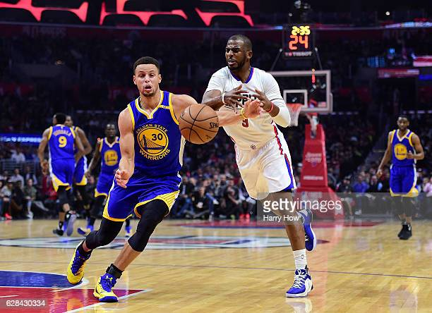 Stephen Curry of the Golden State Warriors steals an inbound pass from Chris Paul of the LA Clippers during the first half at Staples Center on...