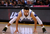 Stephen Curry of the Golden State Warriors streches during a free throw by the Phoenix Suns at ORACLE Arena on April 2 2015 in Oakland California...