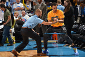 Stephen Curry of the Golden State Warriors stretches before Game Four of the Western Conference Finals against the Oklahoma City Thunder during the...