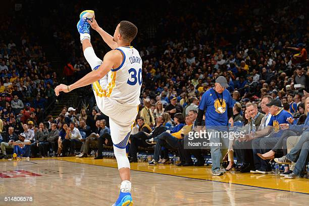 Stephen Curry of the Golden State Warriors stretches before the game against the Utah Jazz on March 9 2016 at Oracle Arena in Oakland California NOTE...