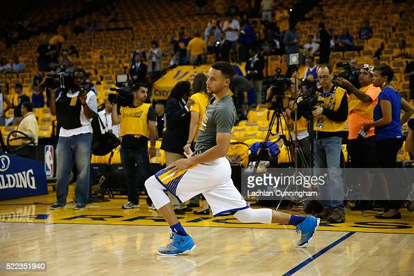 Stephen Curry of the Golden State Warriors stretches in the pregame warm up before Game Two of the Western Conference Quarterfinals against the...