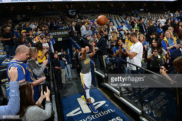 Stephen Curry of the Golden State Warriors takes a shot from the tunnel before the game against the Oklahoma City Thunder on November 3 2016 at...