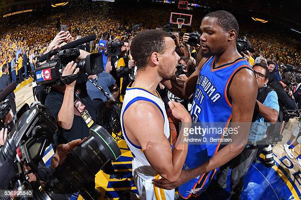 Stephen Curry of the Golden State Warriors talks to Kevin Durant of the Oklahoma City Thunder after Game Seven of the Western Conference Finals...
