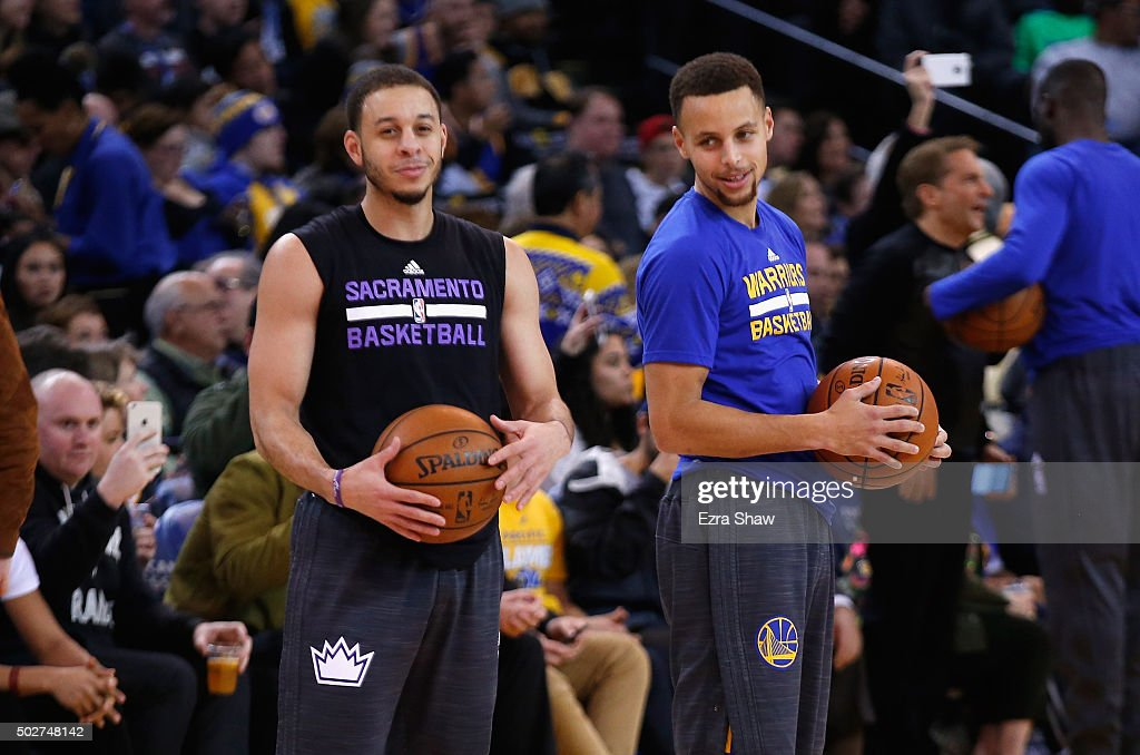 <a gi-track='captionPersonalityLinkClicked' href=/galleries/search?phrase=Stephen+Curry+-+Basketball+Player&family=editorial&specificpeople=5040623 ng-click='$event.stopPropagation()'>Stephen Curry</a> #30 of the Golden State Warriors talks to <a gi-track='captionPersonalityLinkClicked' href=/galleries/search?phrase=Seth+Curry&family=editorial&specificpeople=5945068 ng-click='$event.stopPropagation()'>Seth Curry</a> #30 of the Sacramento Kings before their game at ORACLE Arena on December 28, 2015 in Oakland, California.