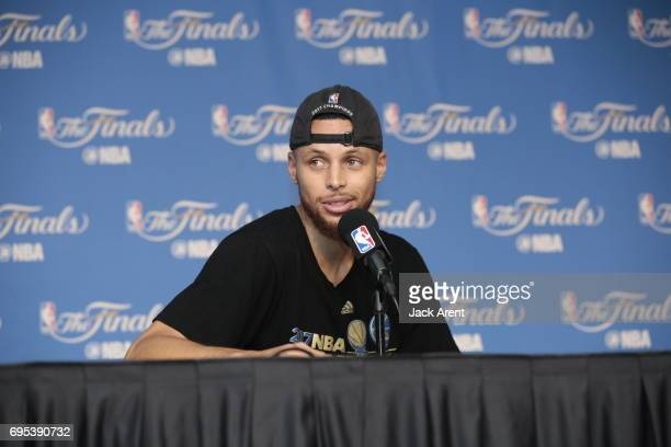 Stephen Curry of the Golden State Warriors talks to the media after winning the NBA Championship against the Golden State Warriors in Game Five of...
