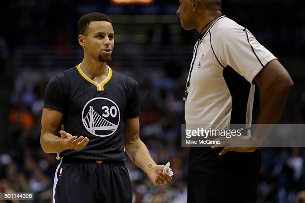 Stephen Curry of the Golden State Warriors talks to the referee after getting called for a technical foul during the third quarter against the...