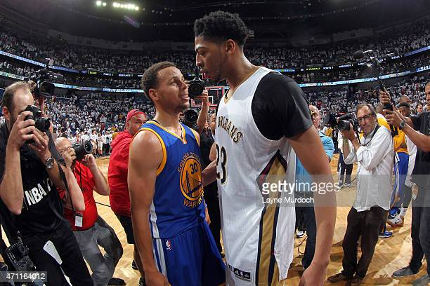 Stephen Curry of the Golden State Warriors talks with Anthony Davis of the New Orleans Pelicans after Game Four of the Western Conference...