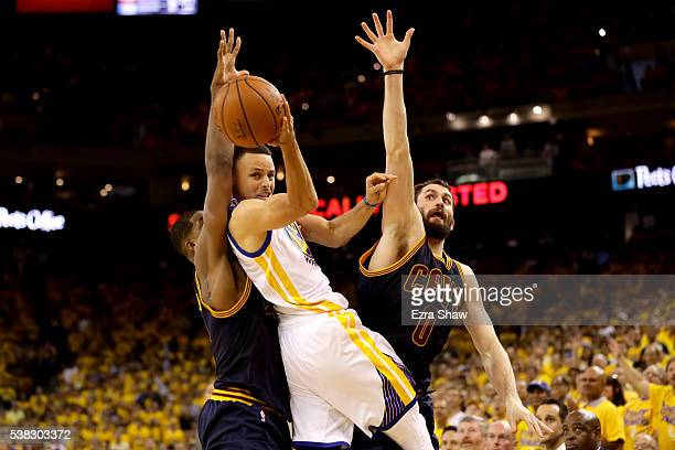 Stephen Curry of the Golden State Warriors throws up a shot against Tristan Thompson and Kevin Love of the Cleveland Cavaliers in Game 2 of the 2016...