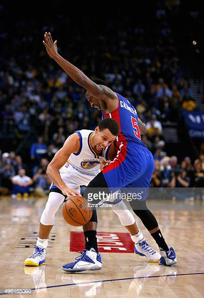 Stephen Curry of the Golden State Warriors tries to dribble around Kentavious CaldwellPope of the Detroit Pistons at ORACLE Arena on November 9 2015...