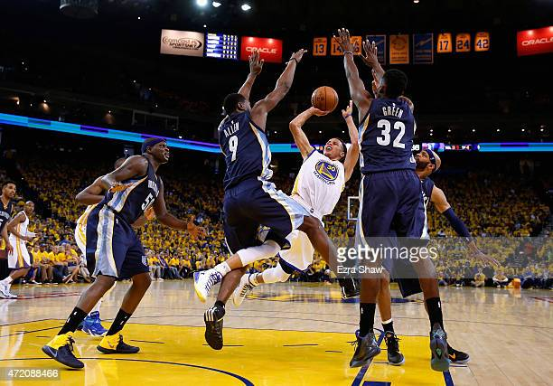 Stephen Curry of the Golden State Warriors tries to get a shot off while surrounded by Memphis Grizzlies players during Game One of the Western...