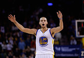 Stephen Curry of the Golden State Warriors tries to get the crowd louder during the fourth quarter of their game against the Houston Rockets at...