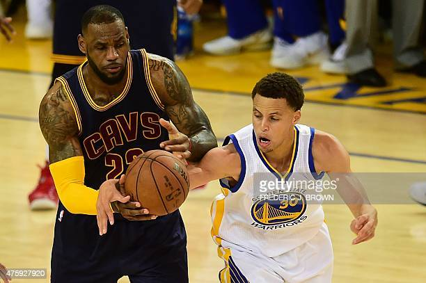 Stephen Curry of the Golden State Warriors vies for the ball with LeBron James of the Cleveland Cavaliers in overtime during Game 1 of teh 2015 NBA...