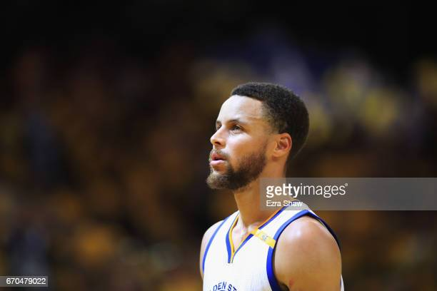 Stephen Curry of the Golden State Warriors walks back on to the court after a time out during their game against the Portland Trail Blazers in Game...