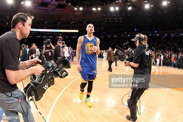 Stephen Curry of the Golden State Warriors walks off the court after his team's loss against the New York Knicks a game in which he scored a career...