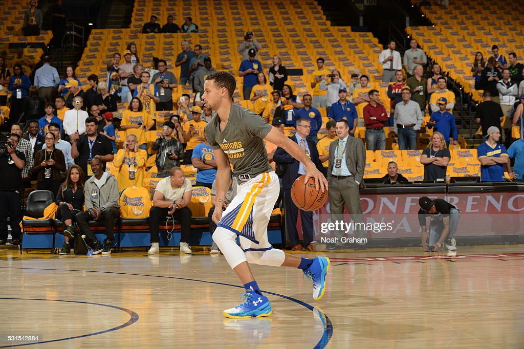 <a gi-track='captionPersonalityLinkClicked' href=/galleries/search?phrase=Stephen+Curry+-+Basketballer&family=editorial&specificpeople=5040623 ng-click='$event.stopPropagation()'>Stephen Curry</a> #30 of the Golden State Warriors warms up before facing the Oklahoma City Thunder for Game Five of the Western Conference Finals during the 2016 NBA Playoffs on May 26, 2016 at ORACLE Arena in Oakland, California.