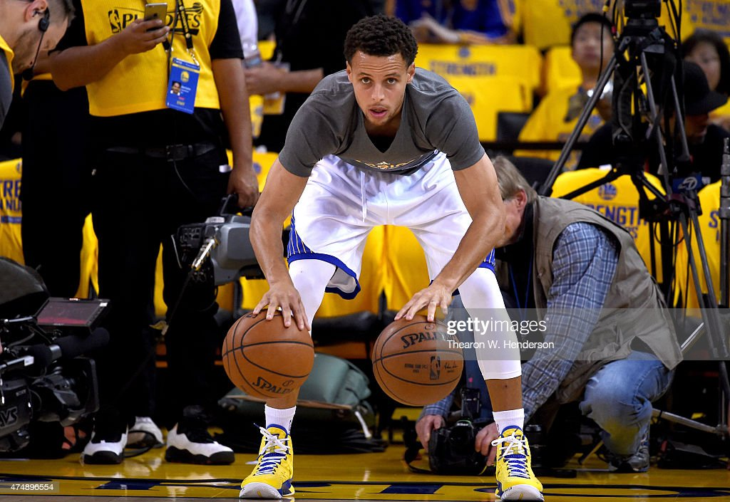 Stephen Curry of the Golden State Warriors warms up before taking on the Houston Rockets in game five of the Western Conference Finals of the 2015...
